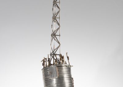 """Logan Woodle """"The only thing that grows here now is cell towers."""" Pewter, Sterling Silver, Copper, Brass, Garnet, 27x6x6 $8000"""