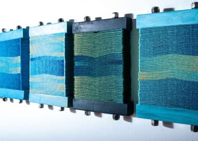 "Susan Hensel ""Chromatic Book Blocks"" Digital embroidery, wood, paint, hardware, 12x48 $2000"